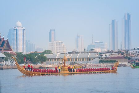 Bangkok, Thailand - October 10, 2019: Royal Barge Anantanakkharat, with 7-headed Thai Fairly Tale Serpent, proceeds down the Chao Phraya River in royal barge procession Training Day. Editorial