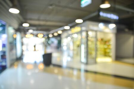 Abstract blur and Light Bokeh Background image of People shopping in Departmentstore retail outlet as Urban lifestyle Concept.