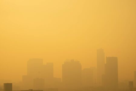 The buildings with yellow smoke in the morning, Smog in the city from PM 2.5 dust, Concept for copy space