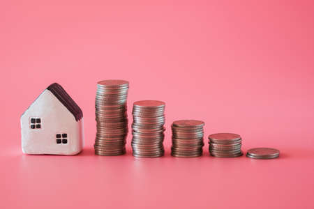 """word from wooden blocks """"safe"""" with mini model home on pink background in staying at home concept."""