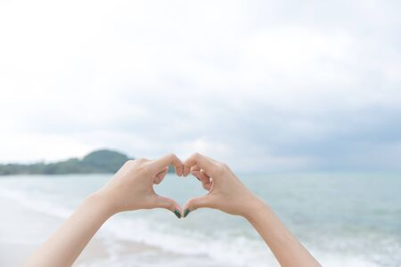 heart with hands over nature background, valentine day background