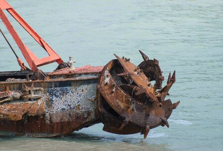 Old rusty propeller ship on the sea Stock Photo