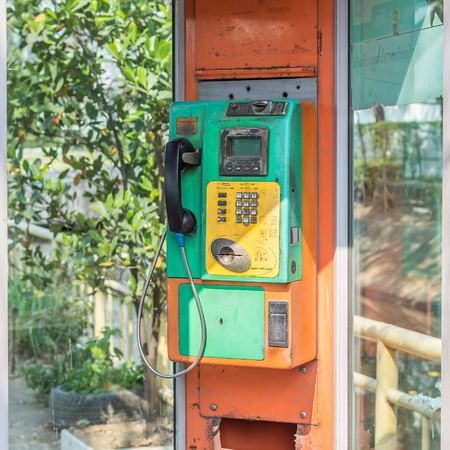 pay wall: old public phone at Thailand, closeup Stock Photo