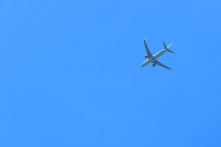 passenger plane: Large passenger plane in the clear blue sky. Stock Photo