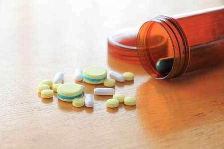 nutritional therapy: Many types of medicines on a wood table refers to health care.