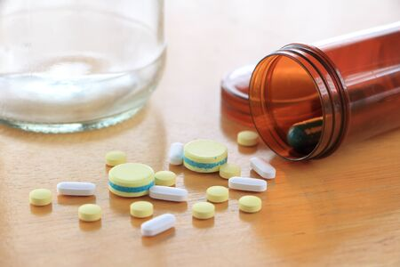alternative living: Many types of medicines on a wood table refers to health care.