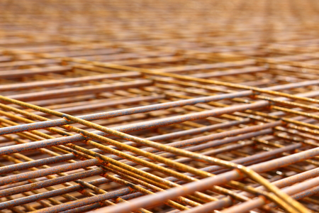 reinforcement: Steel bars for reinforced concrete. Closeup of Steel Bar. Geometric alignment of Re bars on construction site. Rusty is iron rust