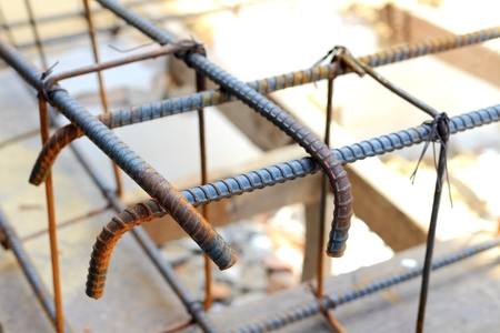 Reinforcement of concrete work.Using steel wire for securing steel bars with wire rod for reinforcement of concrete or cement.