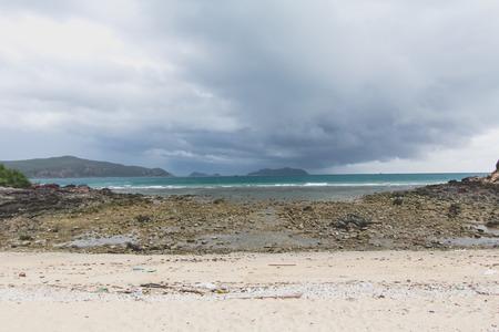 beach rain: Stormy weather with rain on the beach Stock Photo