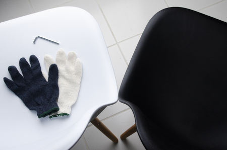 Glove on the wthie chair with ailen key. DIY Concept.