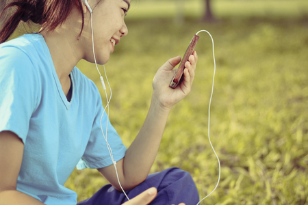 Young Woman Lifestyle Happy Using A Smartphone Outdoors , Filtered images color effect