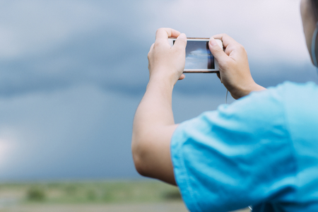 Lifestyle Smartphone Tech User Enjoying Vacation with retro filtered color effect