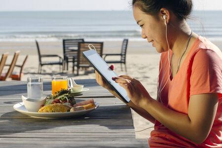 Lifestyle Tablet Tech User On Breakfast Stock Photo