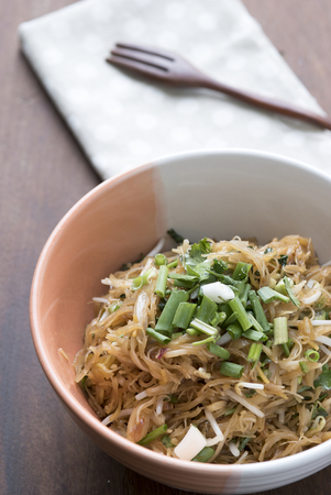 asian cuisine: Vermicelli rice noodles fried with green onions, Asian cuisine food