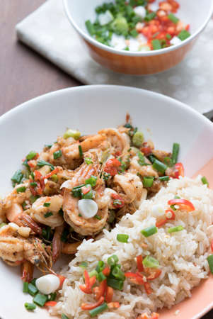 Prawns fried with chilies and green onions, Asian cuisine food photo