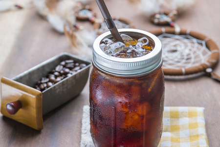 Cold arabica coffee with iced in vintage jar.
