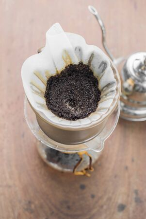 cofe: Making brewed coffee from steaming filter drip style.