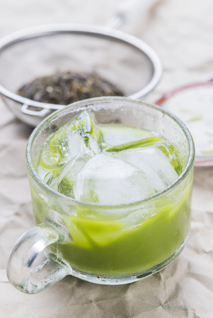 brewed: Cold iced matcha green tea brewed serve in a glass cup.