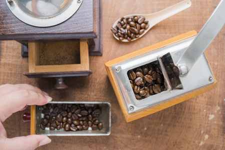 Arabica coffee beans with hand coffee grinder. photo