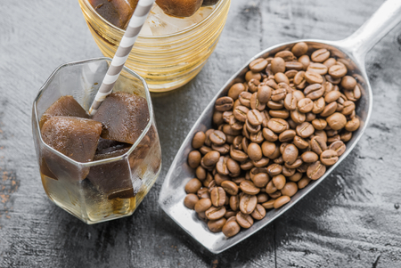 Iced coffee homemade making from ice cubes coffee frozen served in a glass. Stock Photo