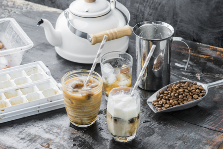 Iced coffee latte homemade making from ice cubes coffee frozen served with milk.