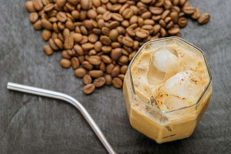 cold meal: Iced latte coffee homemade making from ice cubes frozen served with milk  in a glass. Stock Photo
