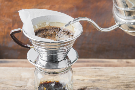 coffee filter: Making brewed arabica coffee from steaming filter drip style.