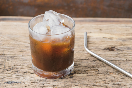 cold beverages: Iced espresso coffee homemade making from ice cubes frozen served in a glass. Stock Photo