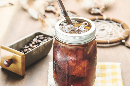 cold meal: Cold arabica coffee with iced in vintage jar.