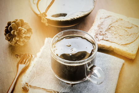 Cup of espresso coffee making by homemade with chocolate bread. Photo in vintage color tone style. Stock Photo