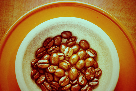 Coffee beans for espresso shot in a cafe or coffee shop. Photo in vintage color tone style. Stock Photo