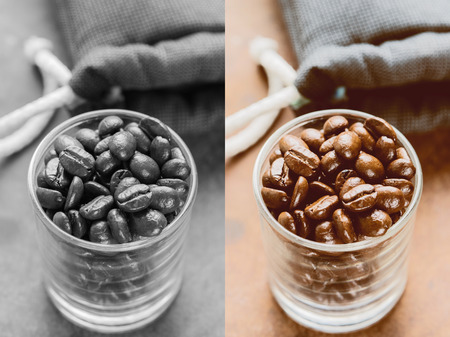 Coffee beans of arabica on texture wooden background. Photo in vintage color tone style. Stock Photo