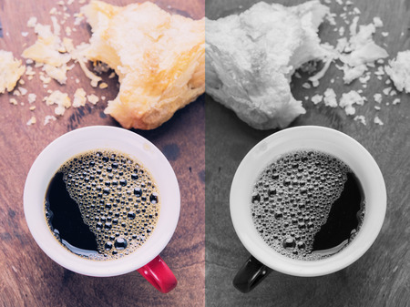 Hot espresso coffee making from Arabica beans served in a cup. Photo in vintage color tone style. Stock Photo
