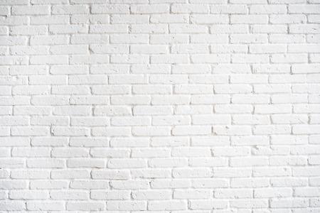 Sfondo vecchio muro di mattoni bianchi.