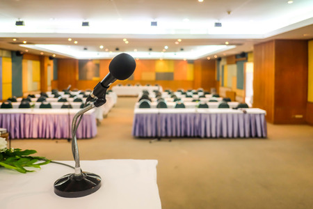 panelist: Close up of microphone in Meeting room hall or conference room