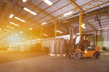 truck driver: Forklift driver standing proud in manufacturing plant Stock Photo