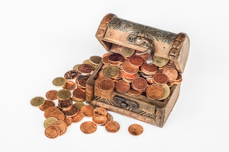 booty pirate: Wooden chest full of coins isolated on white background