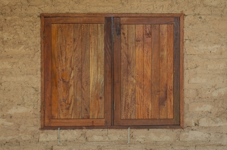 Wooden window of a clay house  photo
