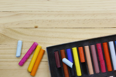 chalks: colorful chalks on  wooden table. Stock Photo