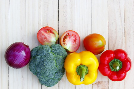 edibles: Vegetables on wooden table.