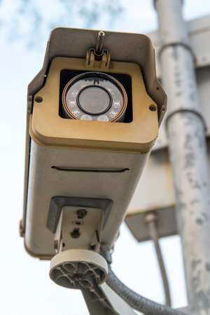 national police agency: Close-up of a CCTV surveillance camera, spying on people. Stock Photo