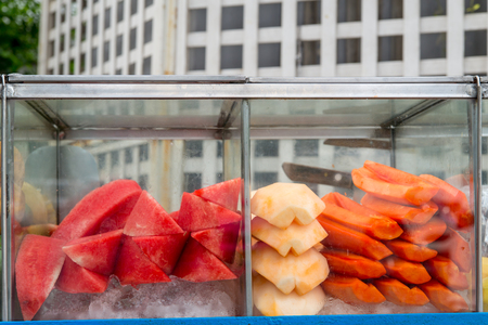 vendor: Fresh assorted fruits in a cart of a street vendor, Bangkok, Thailand.