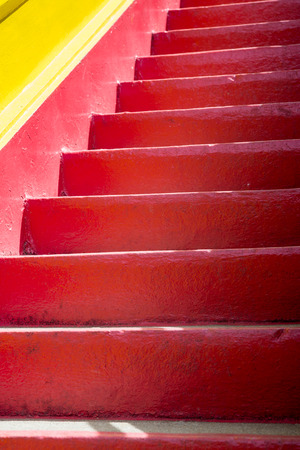 Detail of a red and yellow mediterranean staircase. Mediterranean architectural concept. Stock Photo