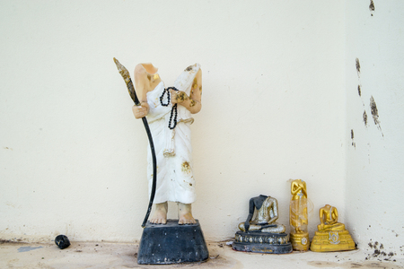 vandalism: Headless statuettes of Buddhas and a Brahman Priest. Buddhism and Hinduism concept.
