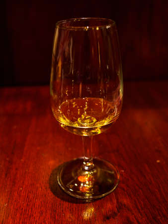 Closeup of a glass of whisky on a wooden mahogany table, traditional British Pub. Tokyo, Japan. Travel and drinks. Stock Photo