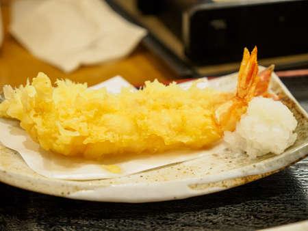 Closeup macro detail of Ebi Tempura fried shrimp along with grated Daikon radish. Narita, Chiba, Japan. Travel and cuisine.