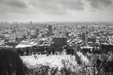 glum: The city full of snow but no sun shine in a cloudy day in winter.