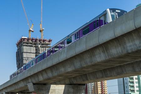 between condominium and railway in modern city.