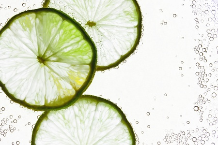 lime slice: Lime in the water Stock Photo