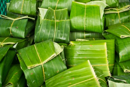 Thai dessert wrapped in banana leaves  Stock Photo